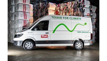 Erstes Elektrofahrzeug für die Containerleerung von Alttextilien